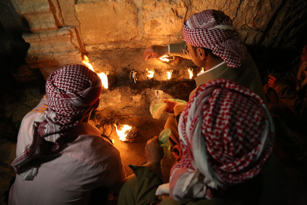Ignite of holy lights in the Ezidi temple of Lalish during New Year ceremony (Emrah Yorulmaz/AA)