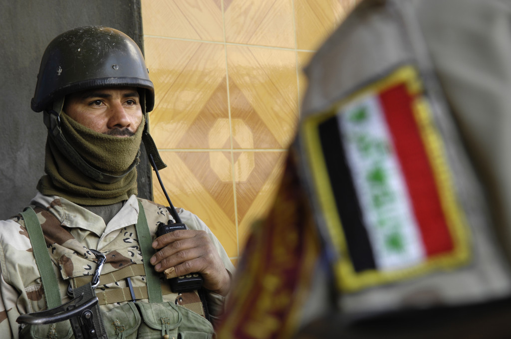 Iraqi army soldiers from 4th Battalion, 2nd Brigade, 5th Division stand outside an Iraqi army compound in Buhriz, Iraq, Jan. 31, 2007. (U.S. Air Force photo by Staff Sgt. Stacy L. Pearsall) (Released)