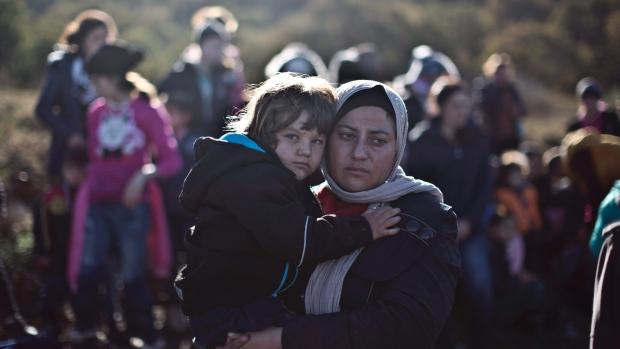 Dayikek êzîdî tevî zaroka xwe, 26. Mijdar (AP/Muhammed Muheisen)