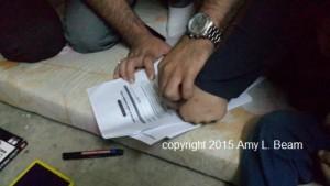 Registrierung eines befreiten êzîdîschen Kindes durch die CYCI (Dr. Amy L. Beam)