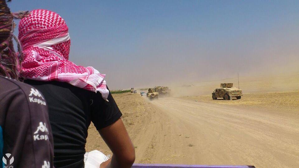 Nur noch eine Staubwolke: Flüchtende Peshmerga in Shingal am 3. August 2014
