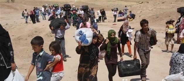Flüchtlinge aus Tal Afar auf dem Weg nach Shingal